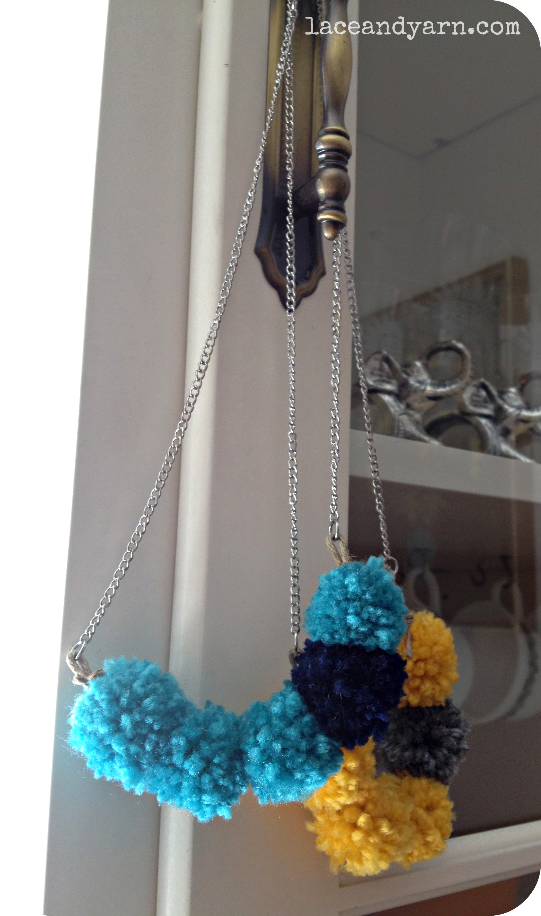yarn pom necklace